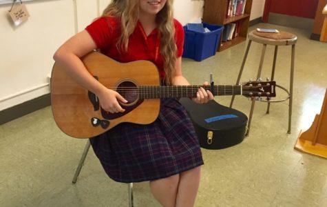 Kat Davis poses with her guitar.
