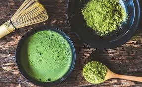 Matcha powder and a traditional matcha latte. Photo from Runner's World.