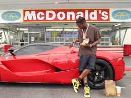 Rapper Travis Scott in front of a Mcdonald