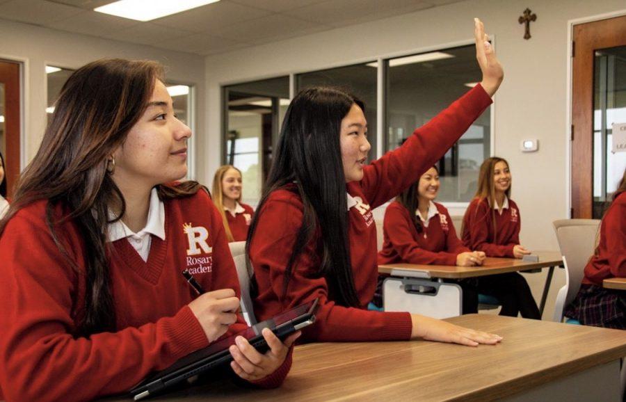Alicia Ventura' 21 and Natalie Kim' 22 having fun while participating in class.