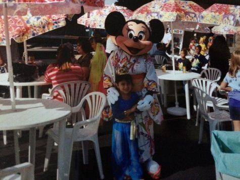 Ms. Torres celebrating Halloween with Minnie Mouse in 1999.