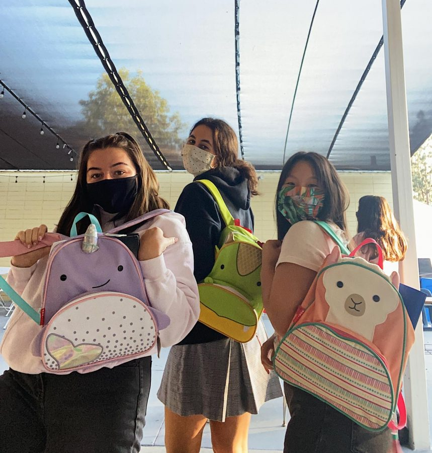 Caroline Linton '21, Amelia Fiorentino '21, and Serena Park '21 showing off their ridiculously small matching backpacks. Photo provided by Serena Park