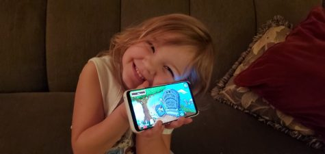 "Hailee with her favorite game ""Plants VS. Zombies"". Photo by Tina Enright"