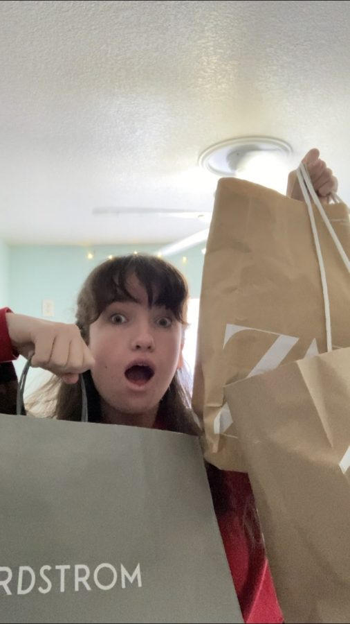 Anna DiCrisi '22 and a few of her Black Friday bags Photo Credit: Anna DiCrisi