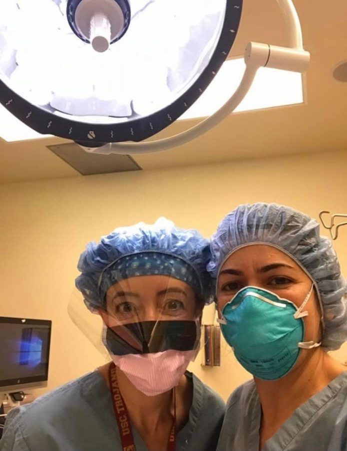 My mom, Dr. Moyers (left), and her best friend, Dr. Tajali, take a selfie in the operating room.