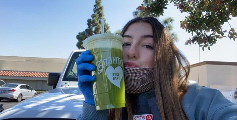 Caroline Linton '21 takes a parking-lot selfie with her very nutritious drink from Mother's Market, where she works. Photo Credit: Caroline Linton
