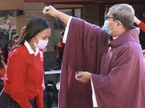 This is a Royal receiving her ashes from Fr. Ian on Ash Wednesday.