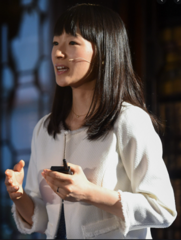 Marie Kondo speaking at  a summit regarding her organization methods.