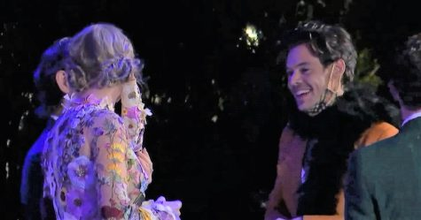 Taylor Swift and Harry Styles talking at the Grammys. Photo by The Grammys Recording Academy