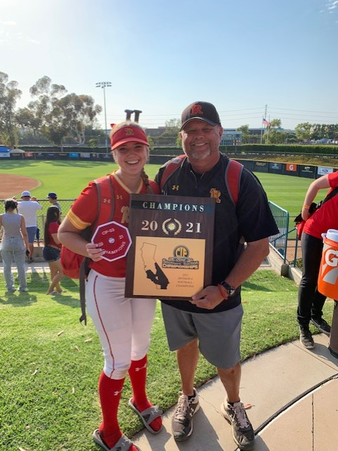 Coach Tice and Abigail Tice '22 proudly hold their award after winning the CIF Championship.