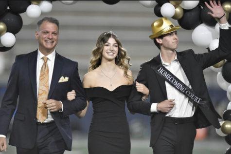 Servite alumnus John Sarni, Servite prince Ian Schutt, and I walk across the football field.