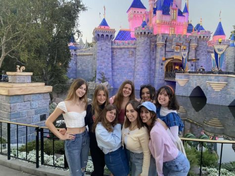 The seniors took a picture in front of the famous castle while dressed up as Disney princesses in casual/modern clothes.  Photo provided by Anna DiCrisi