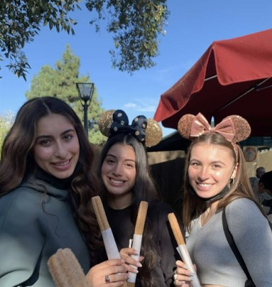 Nicole snaps a picture of her friends enjoying their classic Disney churros.