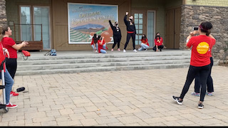One of the groups performing there original dance to BTSs song Butter for the dance competition.