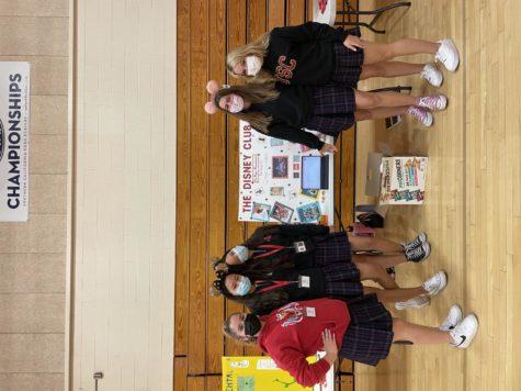 From left to right: Giovana Watson 22, Savannah Kondo 22, Sophia Kondo 22, Katie Thomas 22, and Danielle Perez 22 posing by the Disney Club table! Photo Credit: Natalie Kim